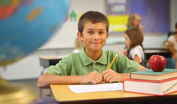Boy student at desk